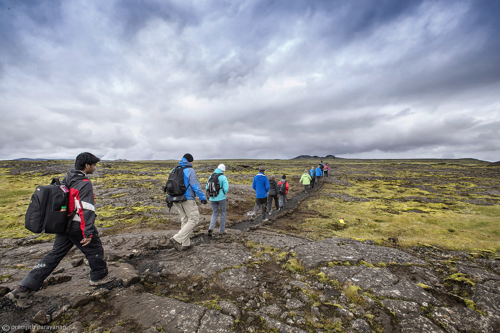 TREKKING  ON  THE  LAVA  FILEDS  TO  REACH  THE  VOLCANO.