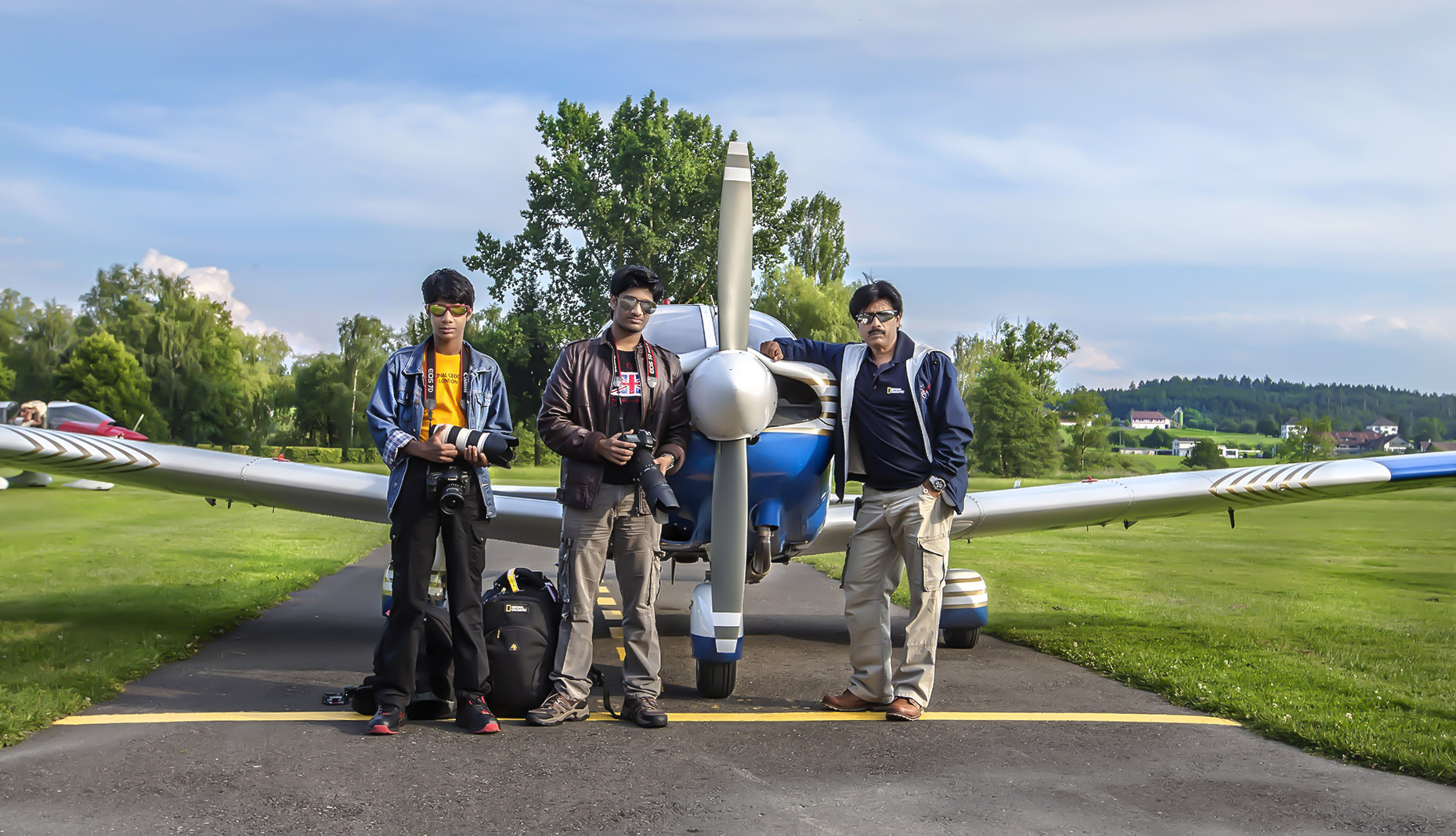 """NITHIN PREMJITH,  JATHIN PREMJITH  &  PREMJITH NARAYANAN  INFRONT  OF  THE  AIRCRAFT  """"PIPER ARCHER II""""."""