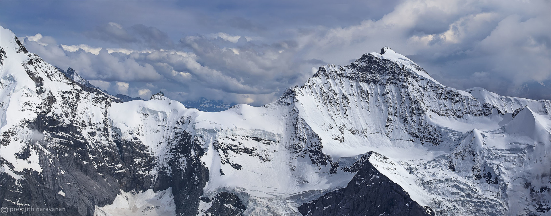 """JUNGFRAUJOCH""  LOCATED  BETWEEN  ""MONCH""  ON  THE  LEFT  AND  ""JUNGFRAU""  ON  THE  RIGHT."